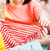 close up of teen girls with shopping bag and shirt stock photo © dolgachov