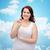 happy plus size woman in underwear with pill stock photo © dolgachov
