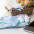 close up of baby clothes, toys and laptop stock photo © dolgachov