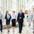 business people walking along office building stock photo © dolgachov