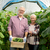 senior couple with box of cucumbers on farm stock photo © dolgachov