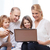 parents and two girls with laptop and credit card stock photo © dolgachov