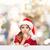 smiling little girl in santa helper hat stock photo © dolgachov