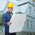 mosolyog · építész · terv · ház · javítás · építkezés - stock fotó © dolgachov