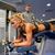 vrouw · spieren · been · druk · machine · gymnasium - stockfoto © dolgachov