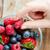 vrouw · handen · bessen · glas · kom - stockfoto © dolgachov