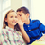 smiling schoolboy whispering to classmate ear stock photo © dolgachov