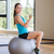 smiling woman with dumbbells and exercise ball stock photo © dolgachov