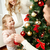 happy family decorating christmas tree at home stock photo © dolgachov