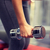 close up of couple with dumbbell exercising in gym stock photo © dolgachov
