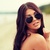 young woman with sunglasses on beach stock photo © dolgachov