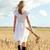 nő · sétál · búzamező · gyönyörű · szőke · nő · nők - stock fotó © dolgachov