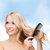 smiling woman with hair brush stock photo © dolgachov