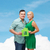smiling couple holding green paper house stock photo © dolgachov