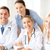 group of doctors with laptop computer stock photo © dolgachov