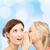 two smiling young women whispering gossip stock photo © dolgachov