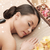 woman in spa salon with hot stones stock photo © dolgachov