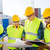 group of builders with tablet pc and blueprint stock photo © dolgachov
