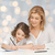 happy mother and daughter writing in notebook stock photo © dolgachov