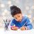little girl drawing stock photo © dolgachov