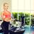 笑みを浮かべて · 若い女性 · パーソナルトレーナー · ジム · フィットネス · スポーツ - ストックフォト © dolgachov