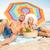 güneşlenme · plaj · renkli · güneş · şemsiyesi · kadın · oturma - stok fotoğraf © dolgachov