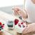 kadın · yeme · çilek · yoğurt · beyaz - stok fotoğraf © dolgachov