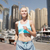 woman running or jogging over dubai city street stock photo © dolgachov