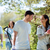 jóvenes · familia · aire · libre · caminando · parque · sonrisa - foto stock © dolgachov