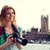 woman with backpack and camera over london big ben stock photo © dolgachov