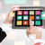 close up of hands holding tablet pc with app icons stock photo © dolgachov