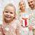 happy family at home with christmas gift box stock photo © dolgachov