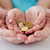 close up of family hands holding euro money coins stock photo © dolgachov