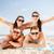 group of happy friends having fun on beach stock photo © dolgachov
