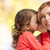 happy mother and girl whispering into ear stock photo © dolgachov