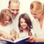 glimlachend · familie · twee · boek · kind - stockfoto © dolgachov