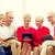sonriendo · familia · computadoras · casa · vacaciones - foto stock © dolgachov