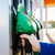 close up of hand holding hose at gas station stock photo © dolgachov