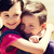 two happy kids hugging outdoors stock photo © dolgachov
