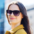 smiling young woman with sunglasses in city stock photo © dolgachov