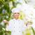 gülen · kadın · şef · salata · kek · plakalar - stok fotoğraf © dolgachov