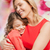 smiling mother and daughter hugging stock photo © dolgachov