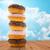 close up of glazed donuts pile over blue sky stock photo © dolgachov