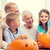 happy family sitting with pumpkins at home stock photo © dolgachov