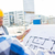 close up of builders with blueprint at building stock photo © dolgachov