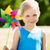 happy little girl with colorful pinwheel at summer stock photo © dolgachov