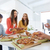 happy business team eating pizza in office stock photo © dolgachov