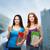 kettő · mosolyog · diákok · táska · mappák · tabletta - stock fotó © dolgachov