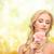 lovely woman with peony flower stock photo © dolgachov
