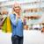boldog · emberek · bevásárlótáskák · mutat · remek · kézmozdulat · vásár - stock fotó © dolgachov